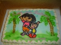 Hand-made Dora and Boots Birthday Cake by a Baltimore baker.  It says Happy 3rd Birthday, Georgeanne
