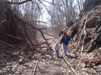 Me and Dinks walking through fallen debris on the tracks