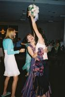 Carolyn catching the bouquet
