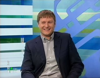 Yevgeny Kafelnikov laughing at Denis Pankratov