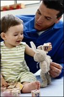Father and child playing with toys