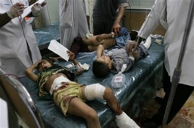 Doctors treat children injured in mortar and gun attack on Al-Mahmudiyah July 17th 2006