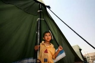 Boy at a refugee camp July 2oth 2006