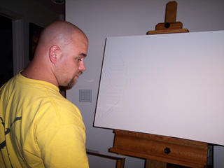 Troy Thomas sketching on a 36x24 gallery wrap canvas