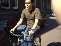 Alex cycling through the streets of Rotterdam