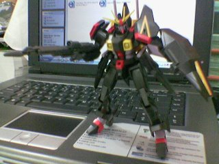 Gaia posing with beam rifle on my laptop