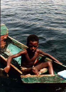 Nubian boy canoe on Nile