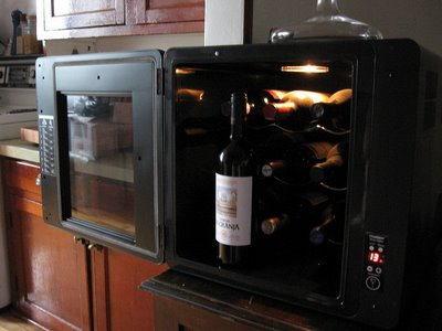 Chambrer wine cellar appliance refrigerator inside view stocked