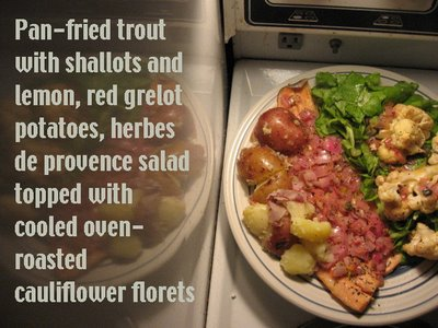 pan-fried trout with shallots and lemon, red grelot potatoes herbes de provence salad topped with cooled oven-roasted cauliflower florets