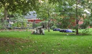 People sleeping in Washington Park