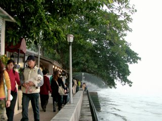 people walking by the sea