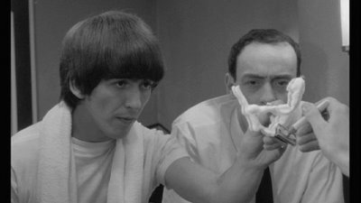 George Harrison y John Junkin en A Hard Day's Night