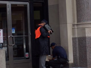 Security officer outside of the Toledo Blade building
