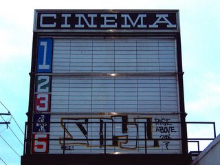Movie theater marquee with graffiti
