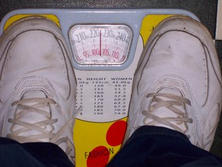 Standing on my scale and monitoring my weight loss