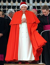 The elderly Pontiff at the audience held outside in St. Peter's Square tried to keep warm with the traditional papal hat: the camauro. The resemblance to Santa Claus has been widely noted.