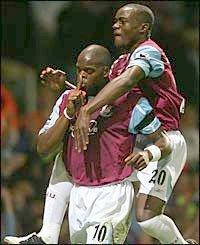 Marlon Harewood scores against Aston Villa