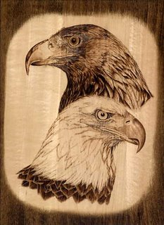 Large plaque of pyrographed bald and golden eagle.