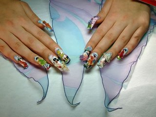 painting on fingernails. japanese theme. you can see japanese ancient art on it. using airbrush