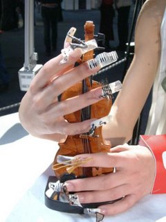 creative nail arts. can you see the musical instrument on fingernails?
