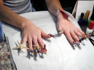 creative fingernails art. this girl uses ocean theme. item included on nails are starfish, seahorse, shell etc