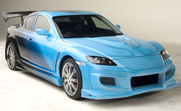 The Mazda RX-8 is a sports car manufactured by Mazda Motor Corporation. It first appeared in 2001 at the North American International Auto Show. It is the successor to the RX-7 and like its predecessors in the RX range it is powered by a Wankel rotary engine.