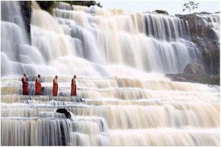 monk in waterfall