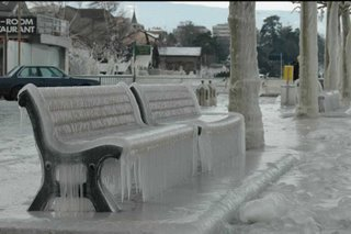 ice covered seat. amazing weather condition we can see here