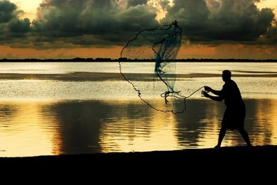 fisherman with net photo
