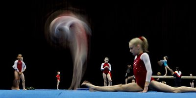 female gymnast performs