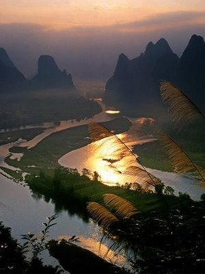 sunset panorama with river and mountain in the background