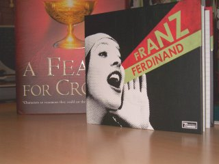 Mi copia de You Could Have It... ante un A Feast for Crows