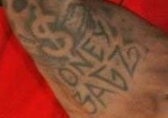 Photo of Money Bagz tattoo from alleniversononlive.com