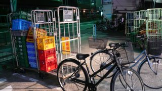 bikes and crates in the early morning infront of the local 99yen shop