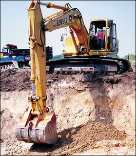 When you're in a hole... hire a JCB