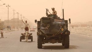 A Saxon APC on patrol in Basra