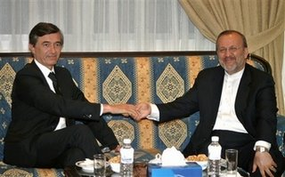Iranian Foreign Minister Manouchehr Mottaki, right, shakes hands with his French counterpart Philippe Douste-Blazy, left, at the Iranian Embassy, in Beirut, Lebanon, Monday, July 31, 2006
