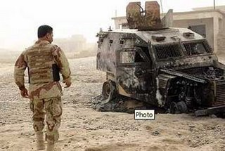 An Iraqi Army armoured Land Rover, destroyed by an IED