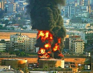 Burning oil tanks at Beirut airport after an Israeli airstrike