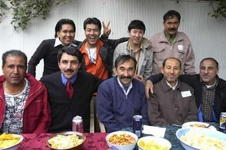 The human face of the problem - successful asylum seekers celebrating their good fortune