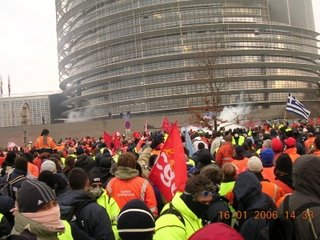 Protestors assemble outside the parliament in Strasbourg