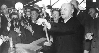 Jean Monnet inspecting the first steel ingot produced under the European Coal and Steel Community regime