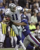 Dallas Cowboys quarterback Drew Bledsoe (11) is sacked for a loss of six yards by New York Giants defensive end Michael Strahan (92) in the 2nd quarter of their football game in Irving, Texas, Monday, Oct. 23, 2006. (AP Photo/L.M. Otero)