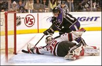 Los Angeles Kings' Anze Kopitar gets the puck past New Jersey Devils goalie Martin Brodeur to score the first goal of an overtime shootout during an NHL hockey game in Los Angeles Monday, Nov. 27, 2006. Kings won 3-2. (AP Photo/Branimir Kvartuc)