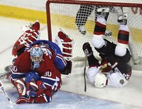 Montreal goaltender David Aebischer collides with teammate Mike Johnson as Ottawa's Patrick Eaves takes a tumble into the net. The Canadiens straightened out well enough to beat the Senators 4-2