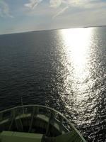 The sun beaming down as the ship surges forward
