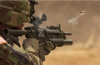 firing an M-4 carbine (c) defenseindustrydaily.com