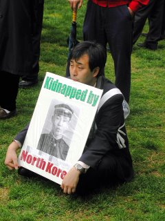 Japanese Man protesting in LaFayette Park