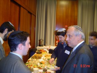 Rabbi Weiss speaking with Michael Schultz at Lieberman Award dinner