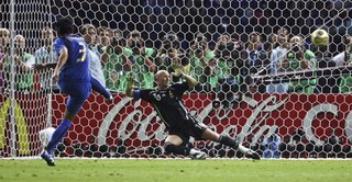 Grosso converting the final penalty, Barthez seeing his world cup dream go past him...